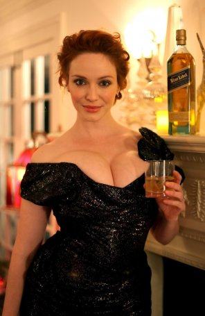 amateur photo Christina Hendricks offering you a drink