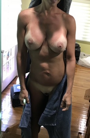 amateur photo Fit hotwife showing off tan lines