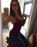 amateur photo Brunette with an iPhone