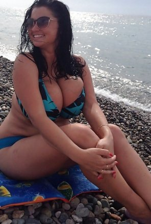 amateur photo Overfilled bikini top on a rocky beach
