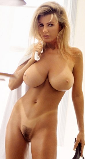 amateur photo Busty blonde with tan lines