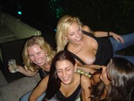 Happy girls laughing with a delightful nip slip