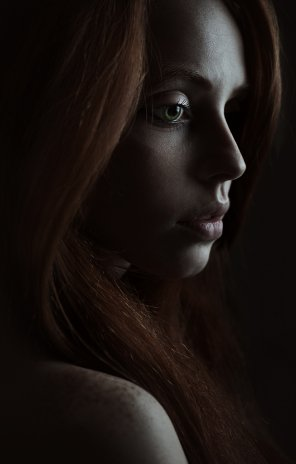 amateur photo redhead in shadows