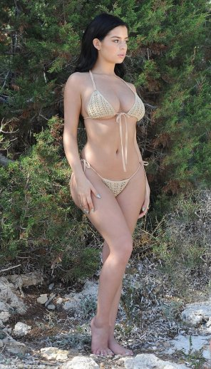 amateur photo Demi sizzled in the tiny bikini bikini which just about managed to contain her ample assets