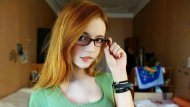 Beautiful ginger in glasses