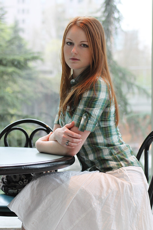 Just a pretty girl fully clothed sitting down