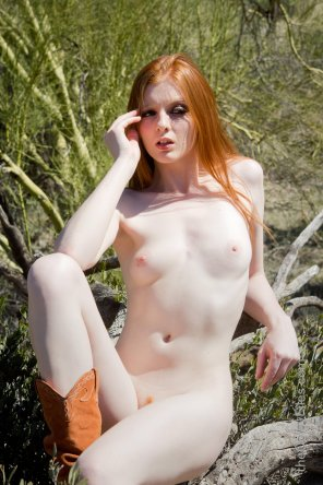 amateur photo Pale natural redhead in cowboy boots