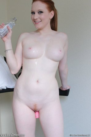 amateur photo Beautiful curvy and pale skinned Redhead Lucy O'hara Poses after a little workout on the treadmill.
