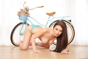 amateur photo Lana Rhoades posing with her bicycle