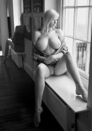 amateur photo Blonde in a window
