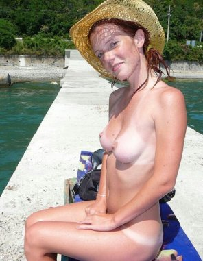 amateur photo Using the hat to protect her face from the sun.