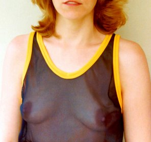 amateur photo Braless MILF in a see through top