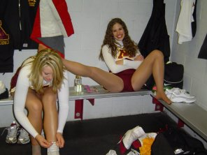 amateur photo Real college cheerleader spreads her legs and smiles in the dressing room