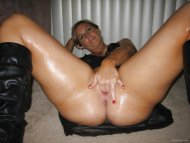 A milf with two fingers in her pussy