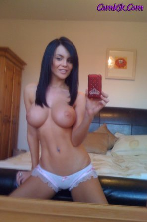 amateur photo Showing off her rack