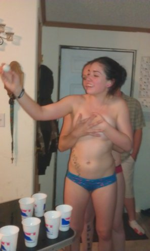 amateur photo Feeling her boobs during a game of beer pong.