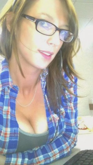 amateur photo Girl with glasses and flannel