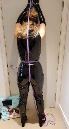 amateur photo Roped and cuffed to the door