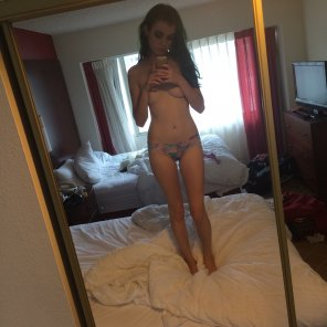 amateur photo Standing on the hotel bed in her panties