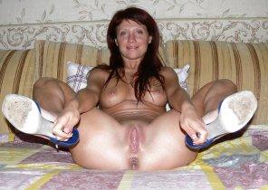 amateur photo Grabbing her heels