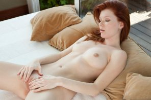 amateur photo Redhead Mia fingers her pussy