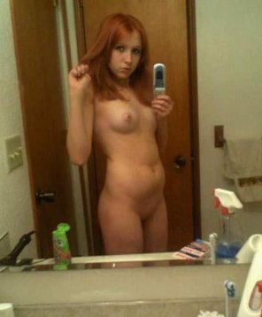 amateur photo Shy Red Teen showing her stuff...