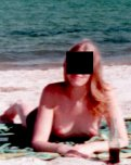 amateur photo MILF topless at the beach