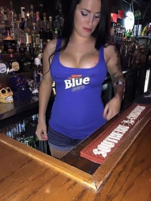 amateur photo Bartender popping out