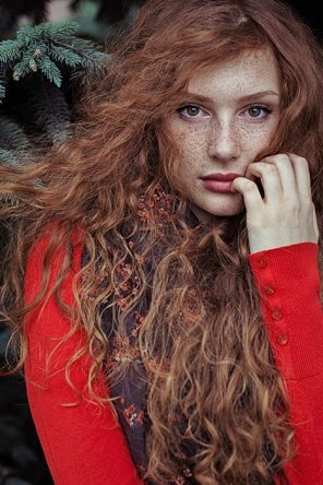 amateur photo Freckles in a blaze of red hair.