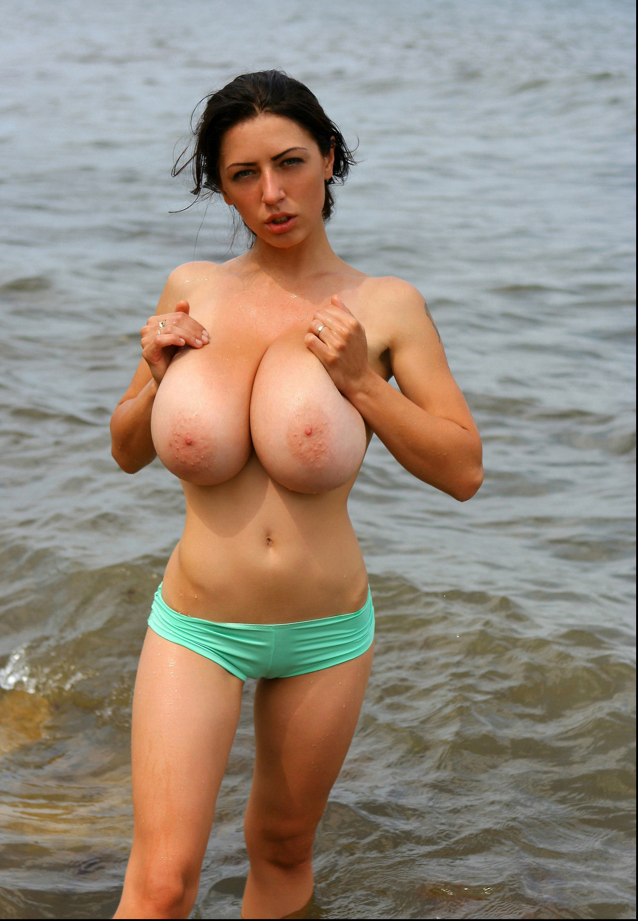huge tits at the beach. porn photo - eporner