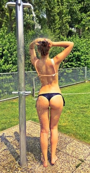 amateur photo Cute girl. Outdoor shower.