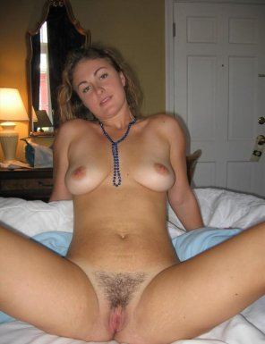 amateur photo Spreading to show her hairy pussy