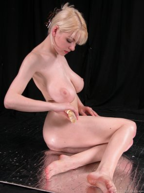 amateur photo Rubbing oil on herself
