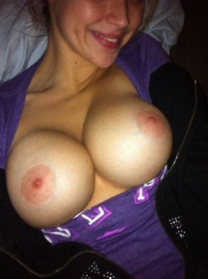 amateur photo Showing off her new tits