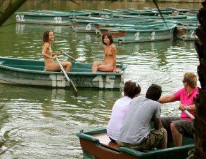 amateur photo Happy embarrassed naked girls enjoying a leisurely ride in a rowboat