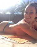 amateur photo Super cutie working on her tan