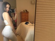 PictureAttractive Girl Wearing Pants Takes Picture of Herself