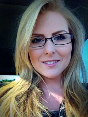 amateur photo Blonde hair, black frames.