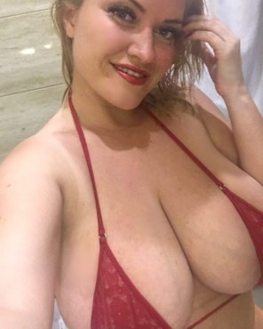 amateur photo That bikini top is way too small for her