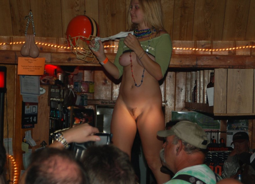 Showing her pussy and tits in a public bar Porn Photo