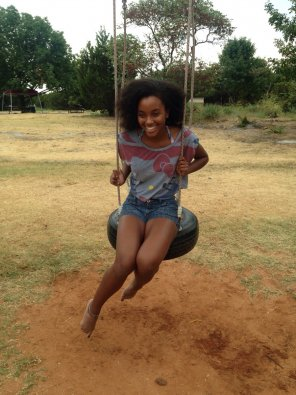 amateur photo Beautiful ebony on a swing