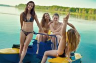 Fit girls on a paddle boat.