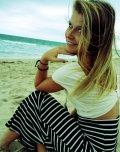 amateur photo Beach in a skirt