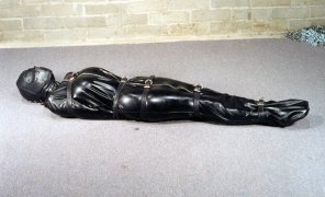 amateur photo Rubber body bag and leather straps lead to a fun play time!