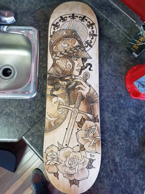 """amateur photo Joan of Arc, wood stain markers and acrylic on skateboard, 8"""" × 32"""""""