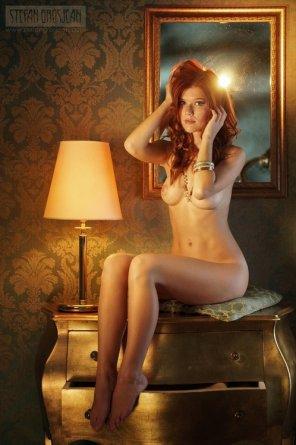 amateur photo sitting on a golden dresser