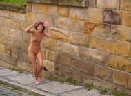 Naked girl acting silly in public