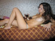 Brunette enjoys a glass of wine