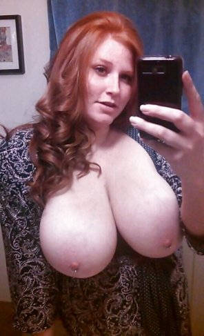 amateur photo Busty, pierced redhead taking a selfie. That´s a lot going on in one picture...
