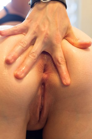 amateur photo Spreading it between her fingers